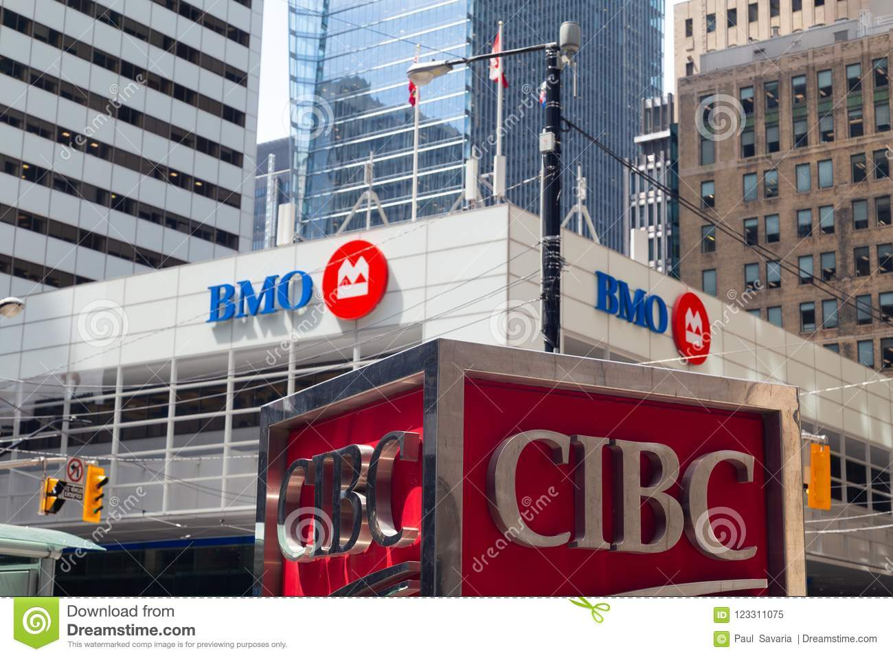 Toronto, Ontario/Canada - July 2018: Bank of Montreal BMO and Canadian Imperial Bank of Commerce CIBC signs logos head office king