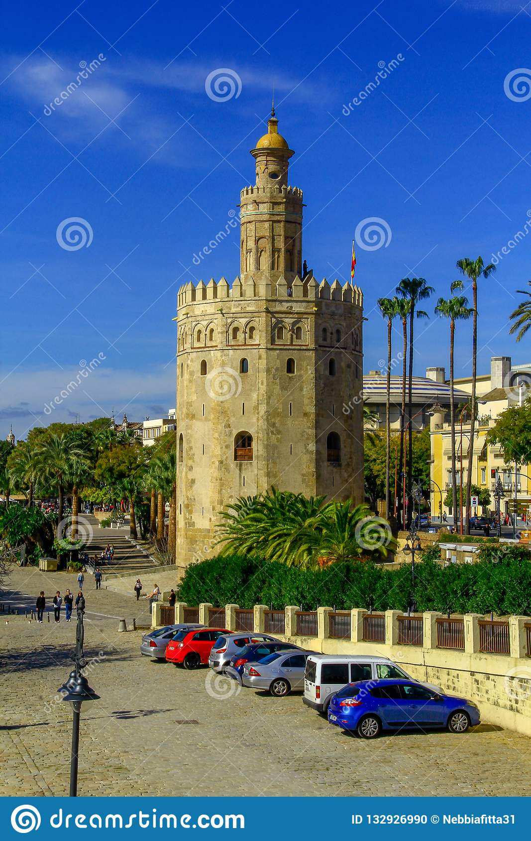 View of Golden Tower Torre del Oro of Seville, Andalusia, Spain over river Guadalquivir at sunset