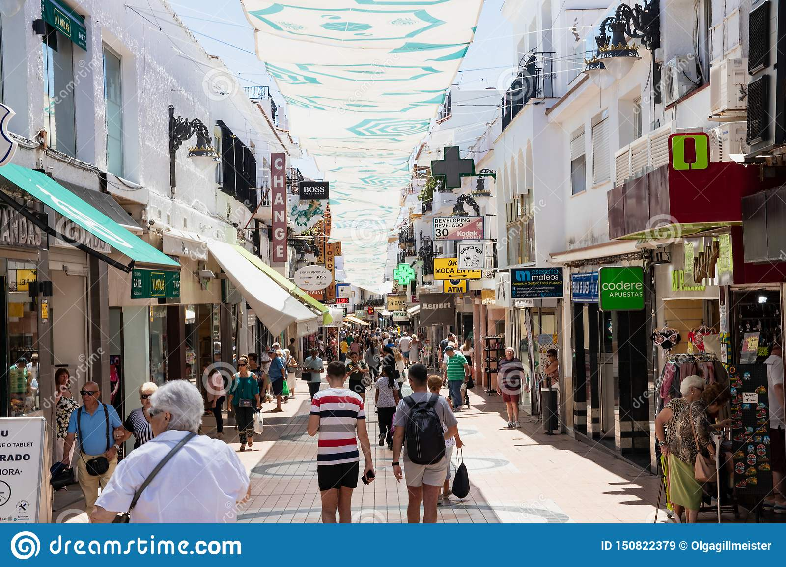 TORREMOLINOS, SPAIN, Andalusia, Costa del Sol - May 21, 2019. Shopper and tourists are walking along most popular street in old