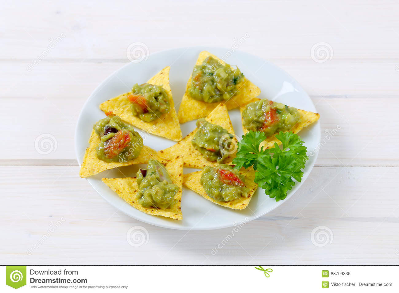 Tortilla Chips With Guacamole Stock Photo