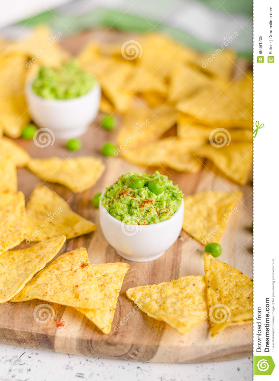 Tortilla chips peas dip stock image. Image of lime ...