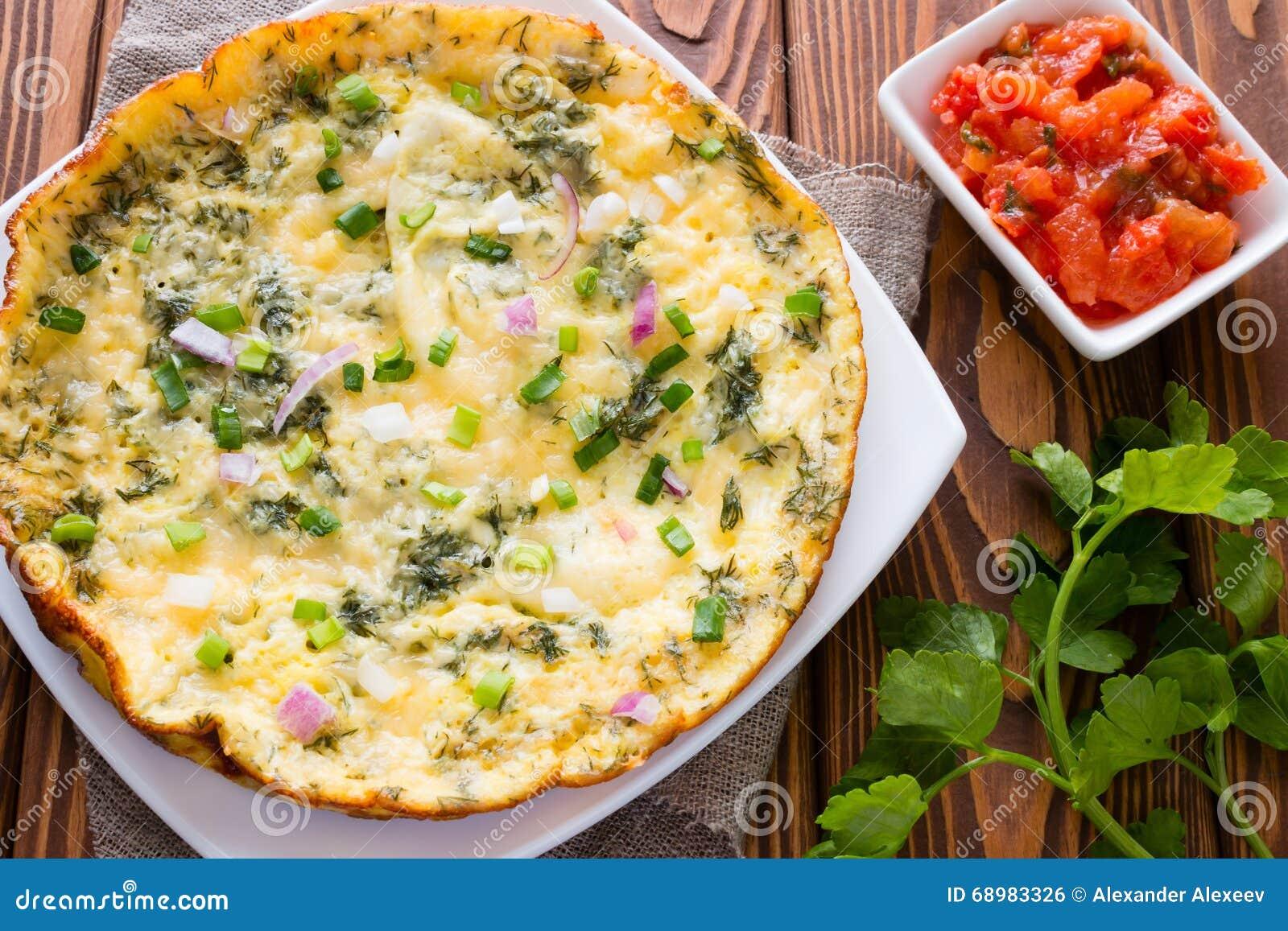 Tortilla, perejil y tomates guisados con hinojo