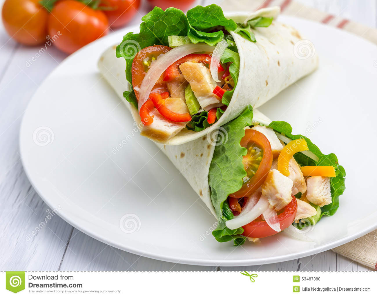 Tortilla wraps with roasted chicken fillet, fresh vegetables and sauce