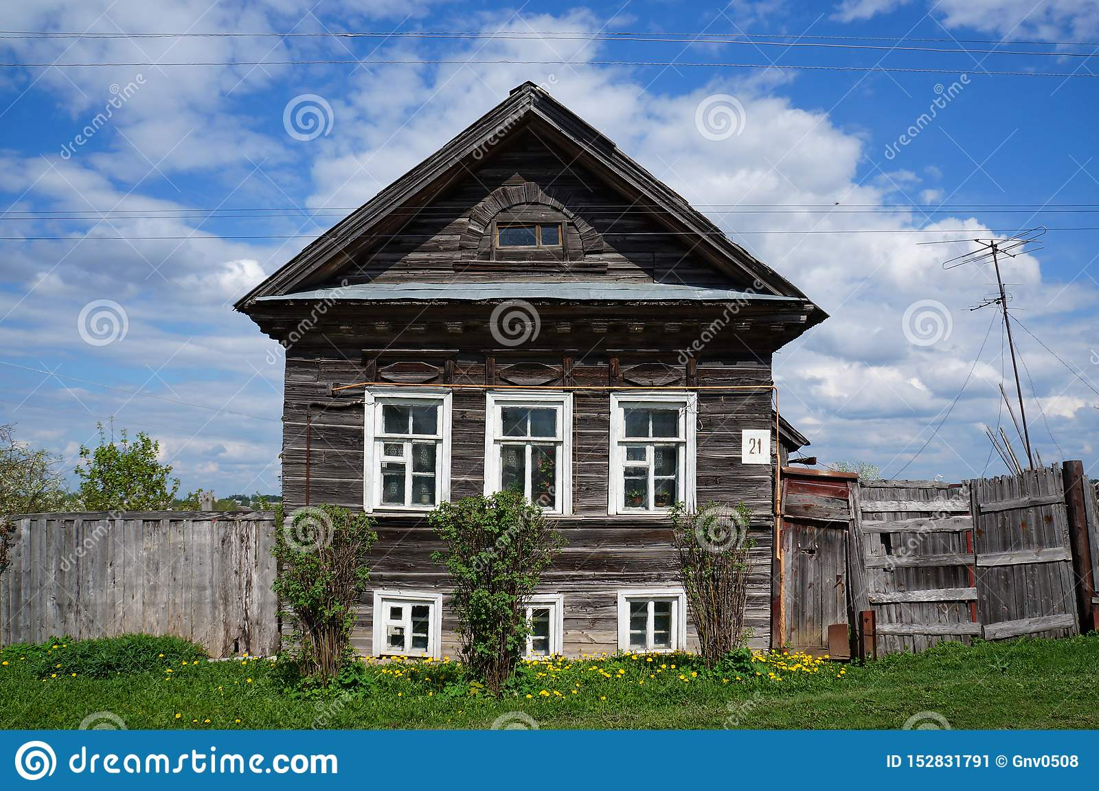 Old wooden house with traditional decorative elements on the facade