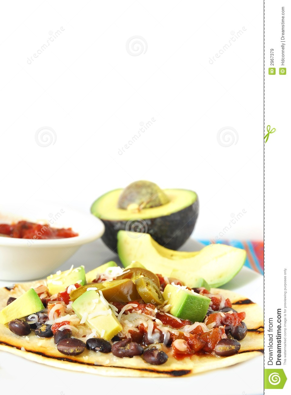 Tostada with black beans, avocado, cheese and salsa. .