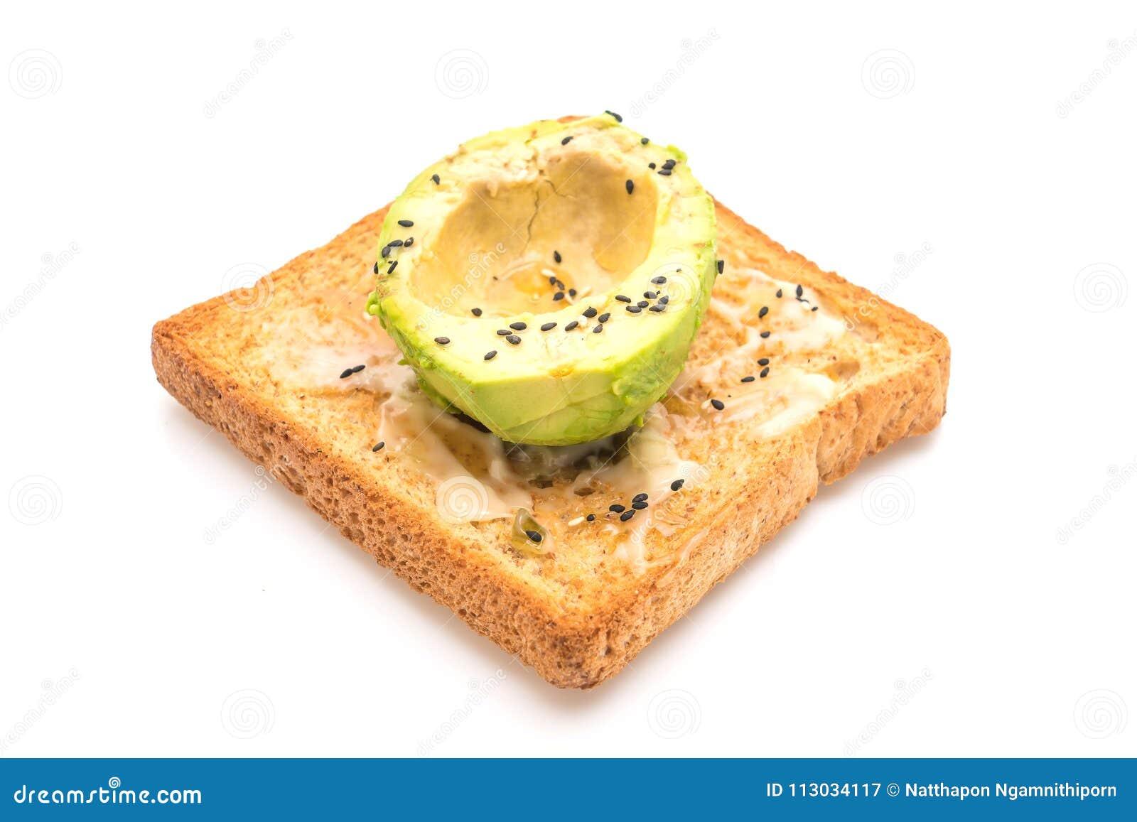 Tostada del pan del trigo integral con el aguacate