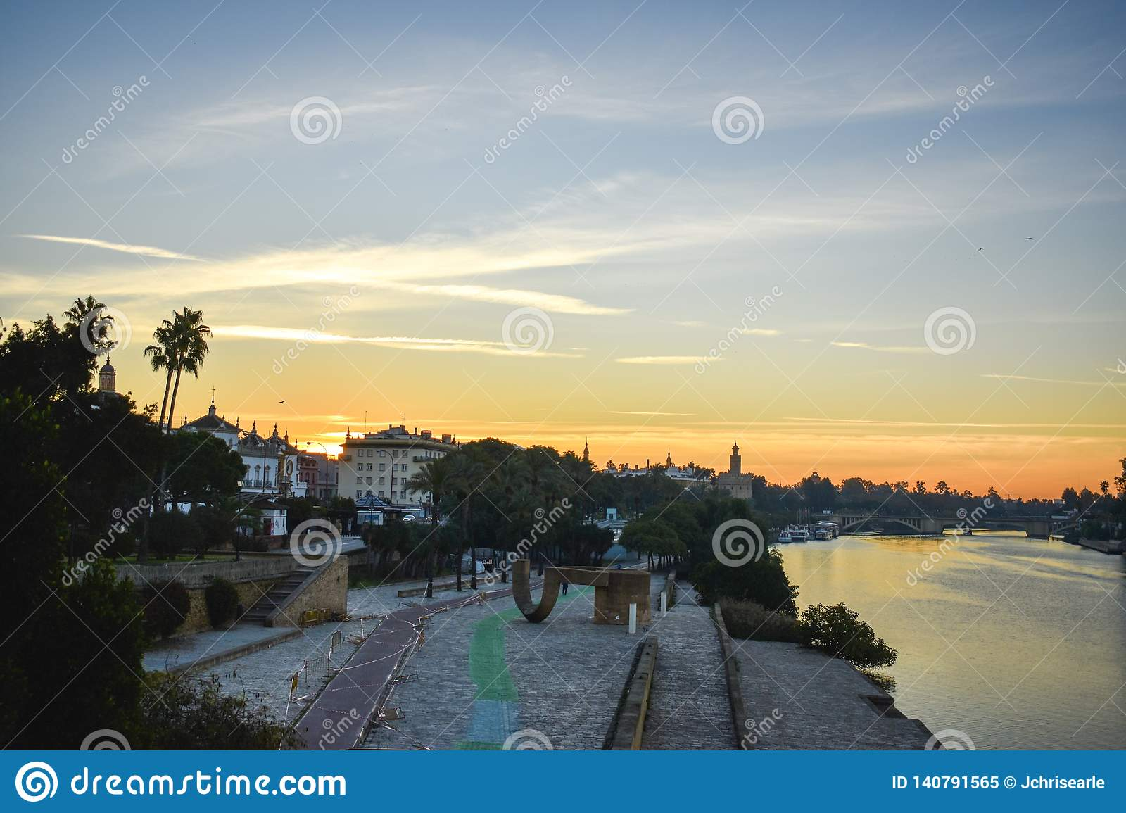 A touch of sunrise over the Guadalquivir river in Seville, Spain