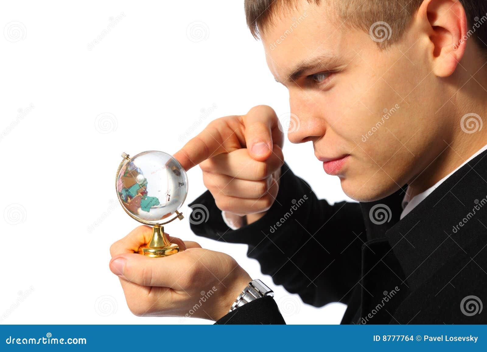 Touches för jordklot för affärsmanfingerexponeringsglas