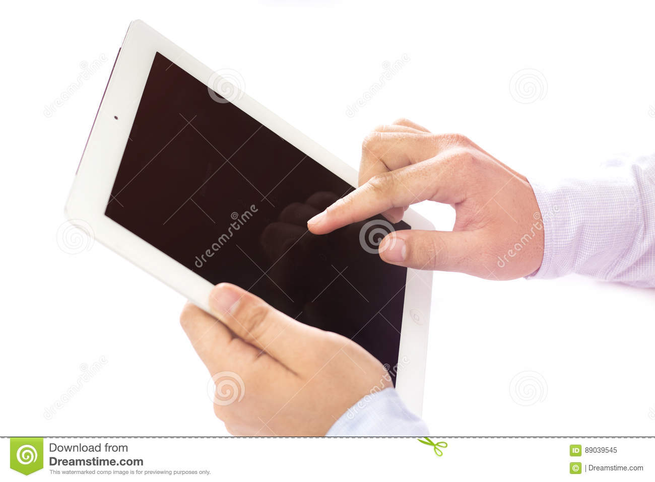 Touching finger in digital touchpad inside a room on a wooden table