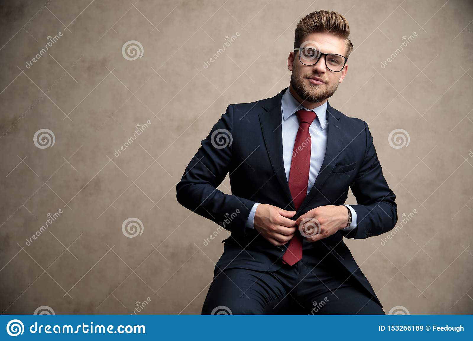 Tough Businessman Fixing His Jacket And Looking Forward