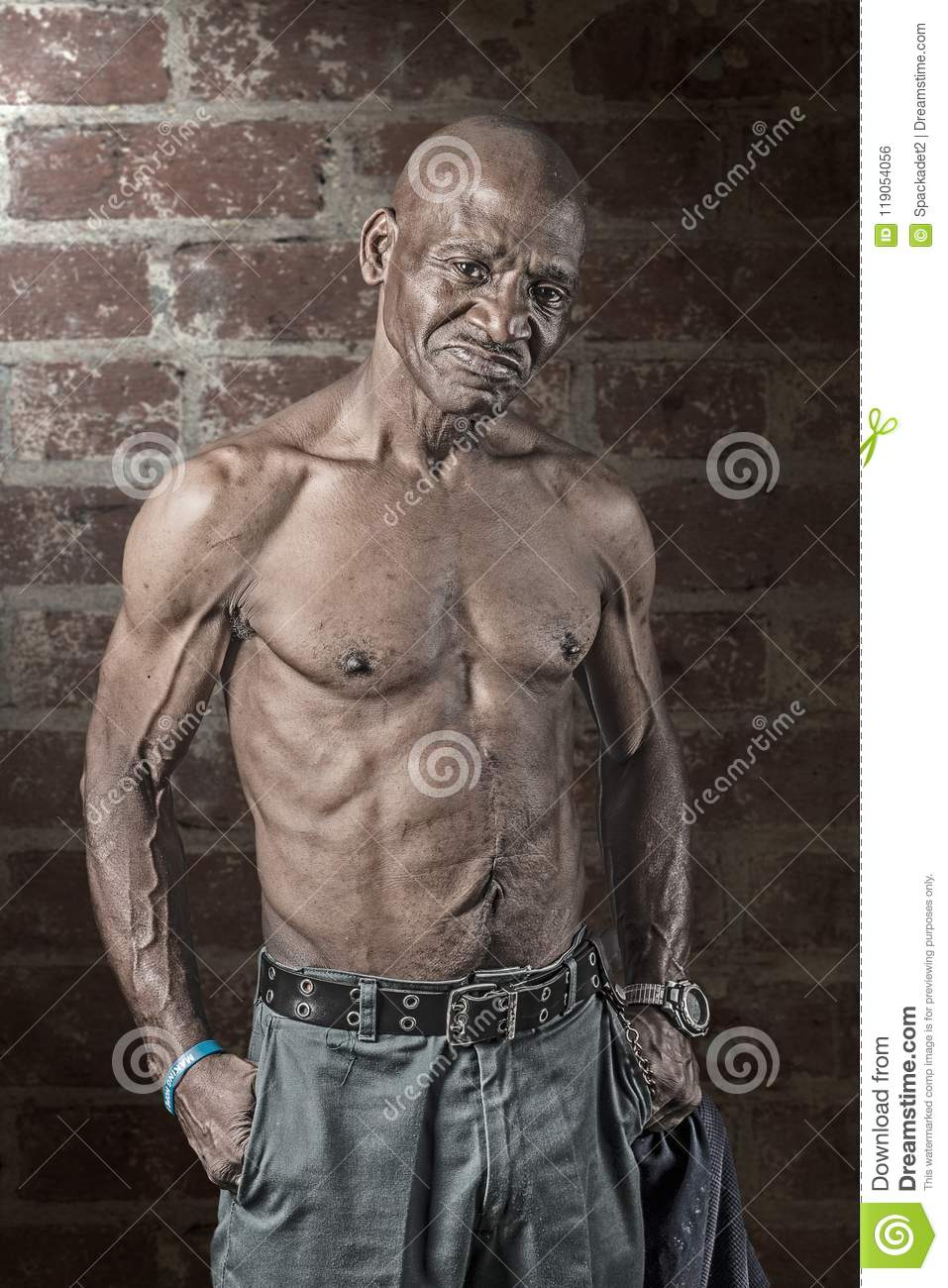 Tough Musular Senior African American Man with large scar on his Abdomen
