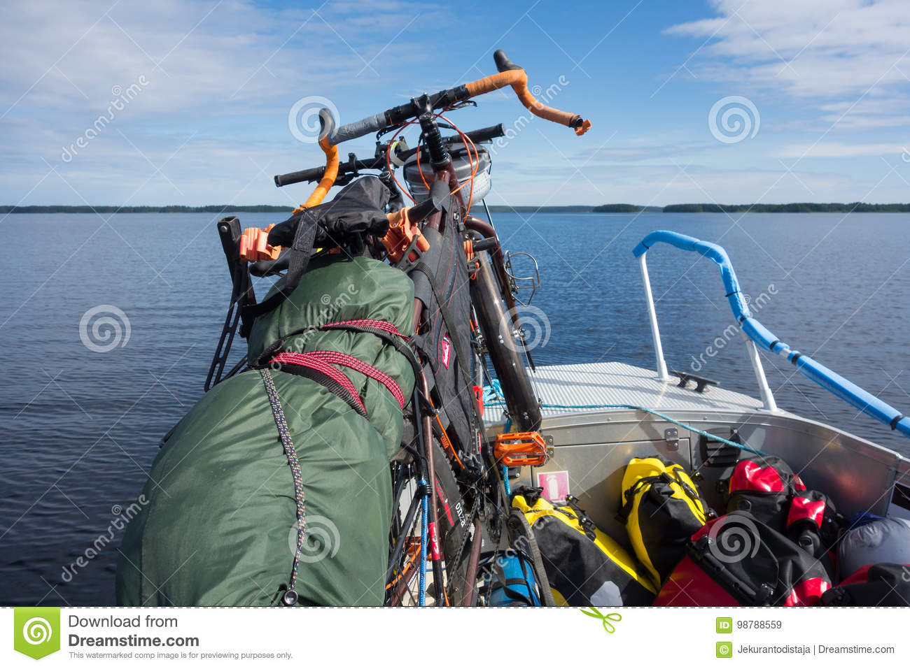 Touring bikes tied securely to a fishing boat on lake Saimaa, Finland