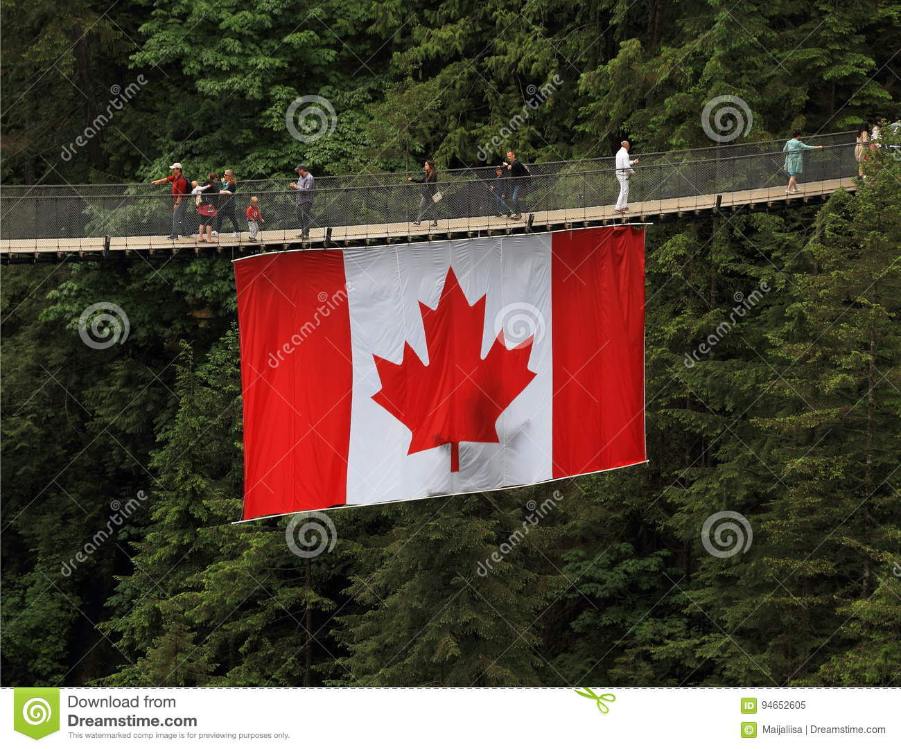 Tourism in Canada: Capilano Suspension Bridge with Canadian Flag