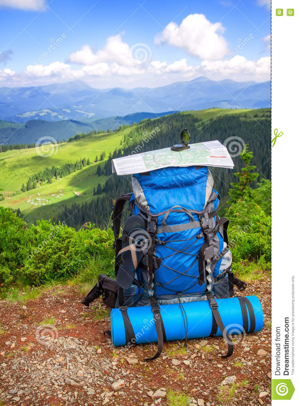 df0814add627 Camping gear and backpack on a background of mountains. Backpack traveler  and map on mountains background. Mountains landscape and big backpack with  map