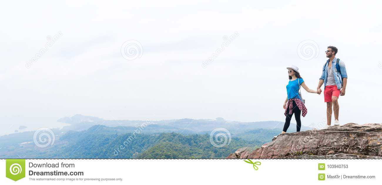 Tourist Couple With Backpack Holding Hands On Mountain Top Enjoy Beautiful Landscape Panorama