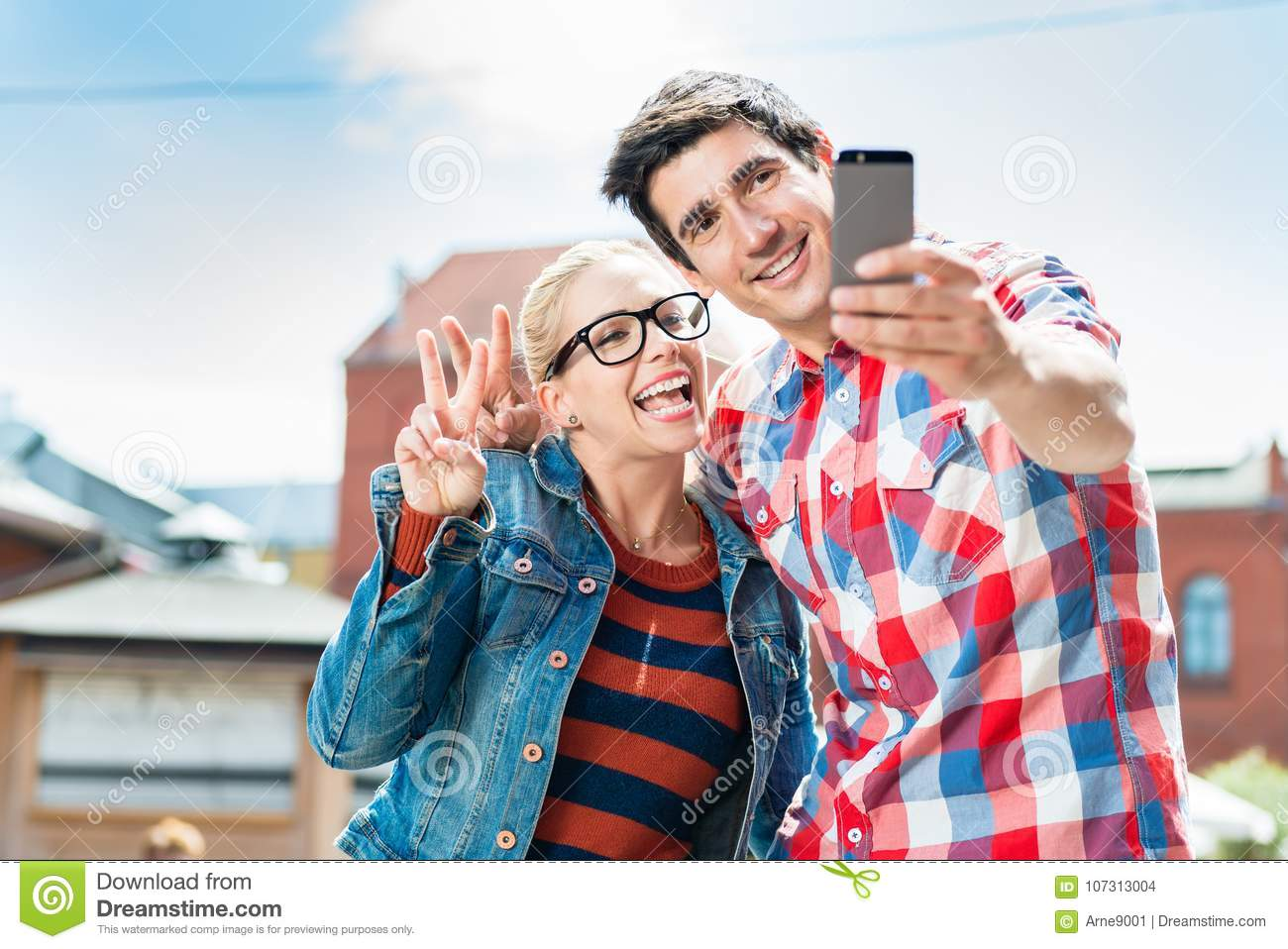 Tourist couple taking selfie on rooftop in Berlin