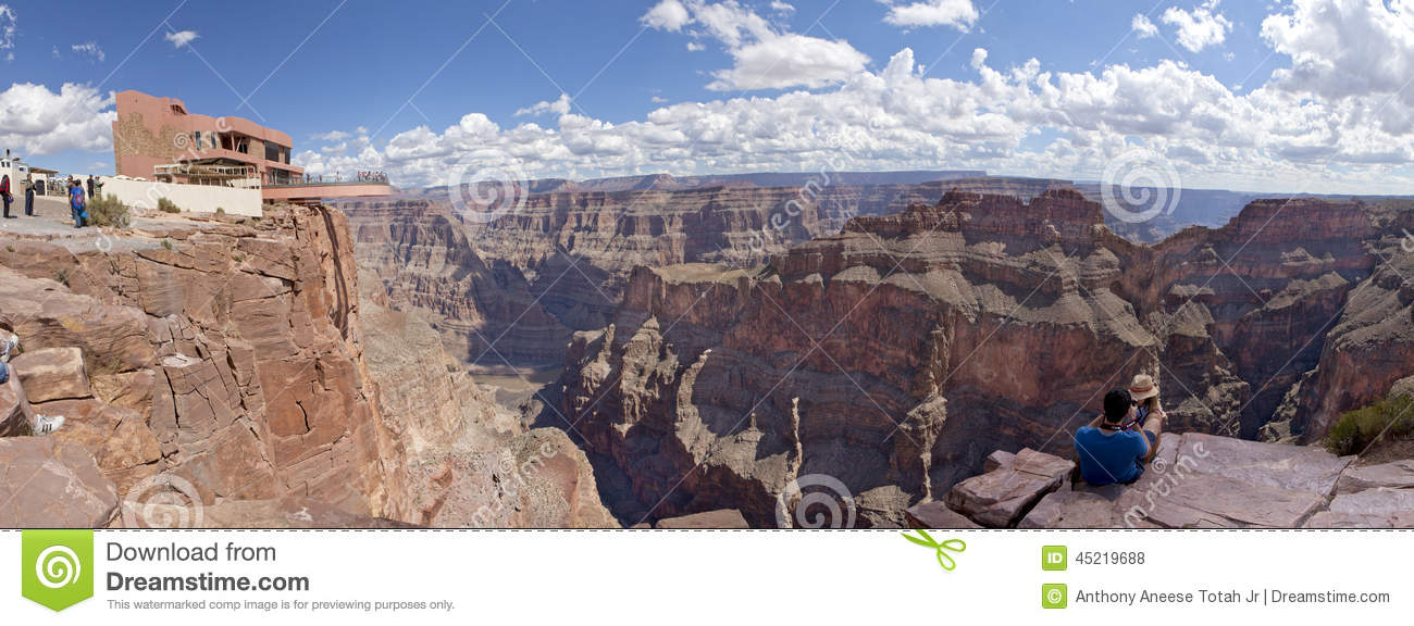 Tourist Enjoying The View Of The West Rim Of The Grand