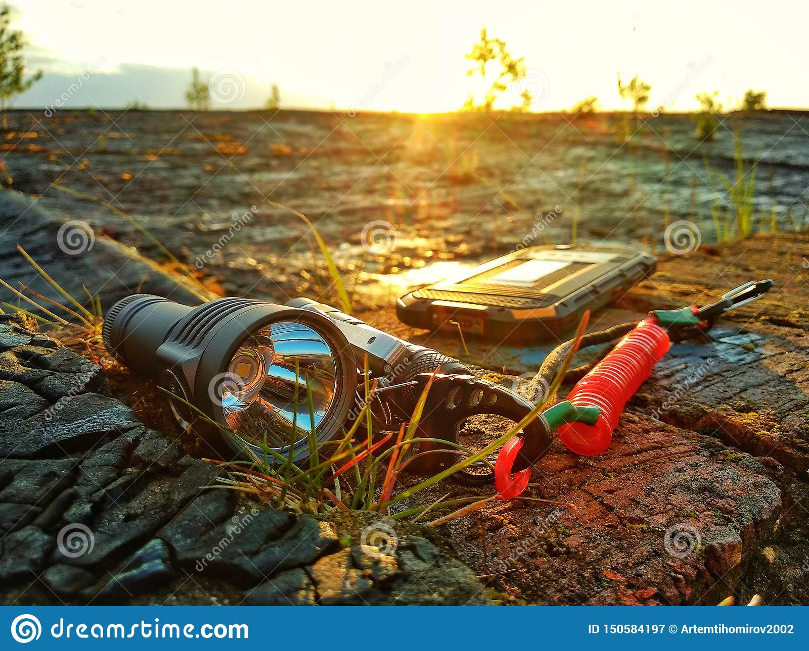 Tourist equipment: a flashlight, a knife, a protected telephone