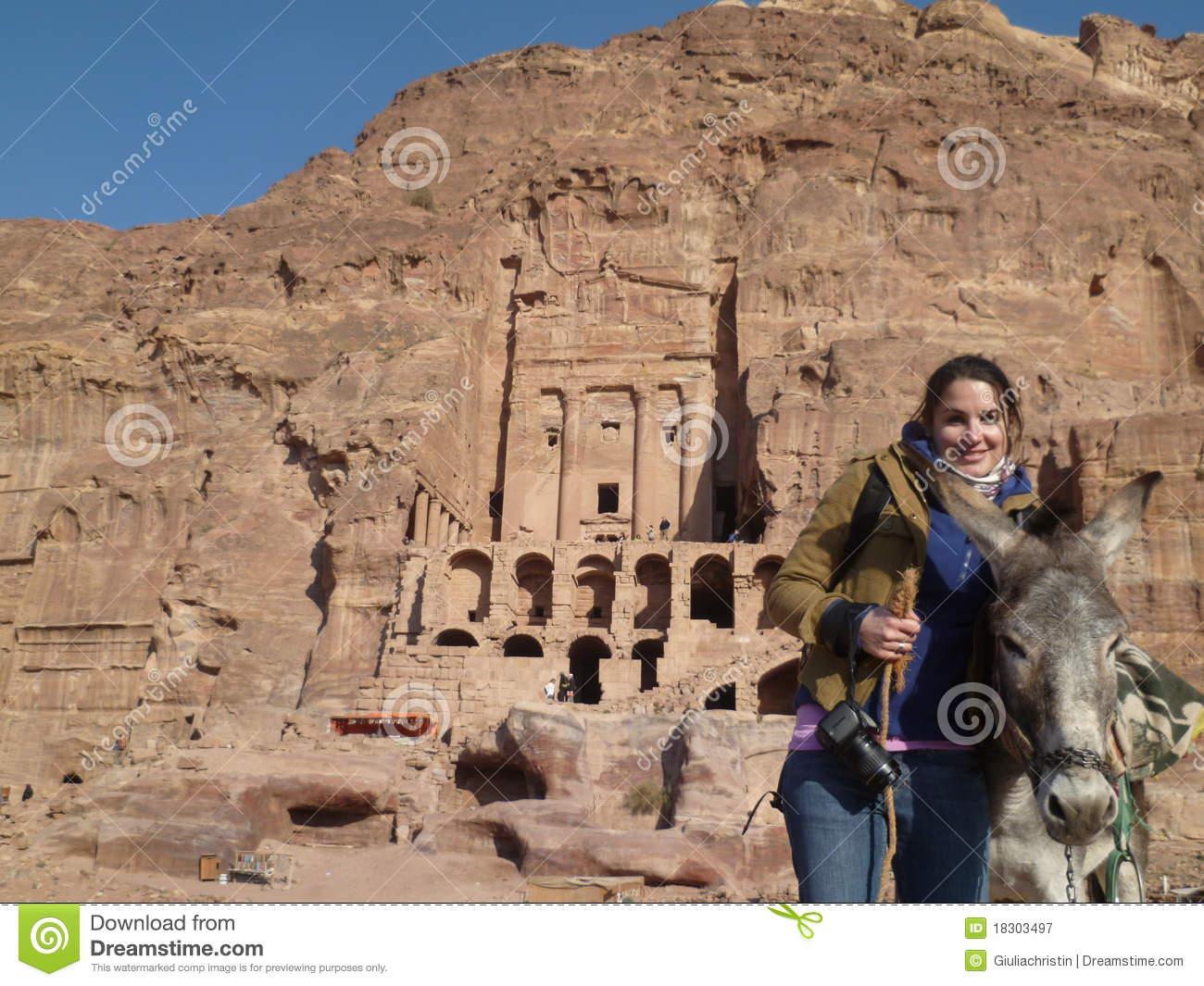 quality design b671a 161a5 Tourist girl holding donkey in Petra Jordan royalty free stock photography