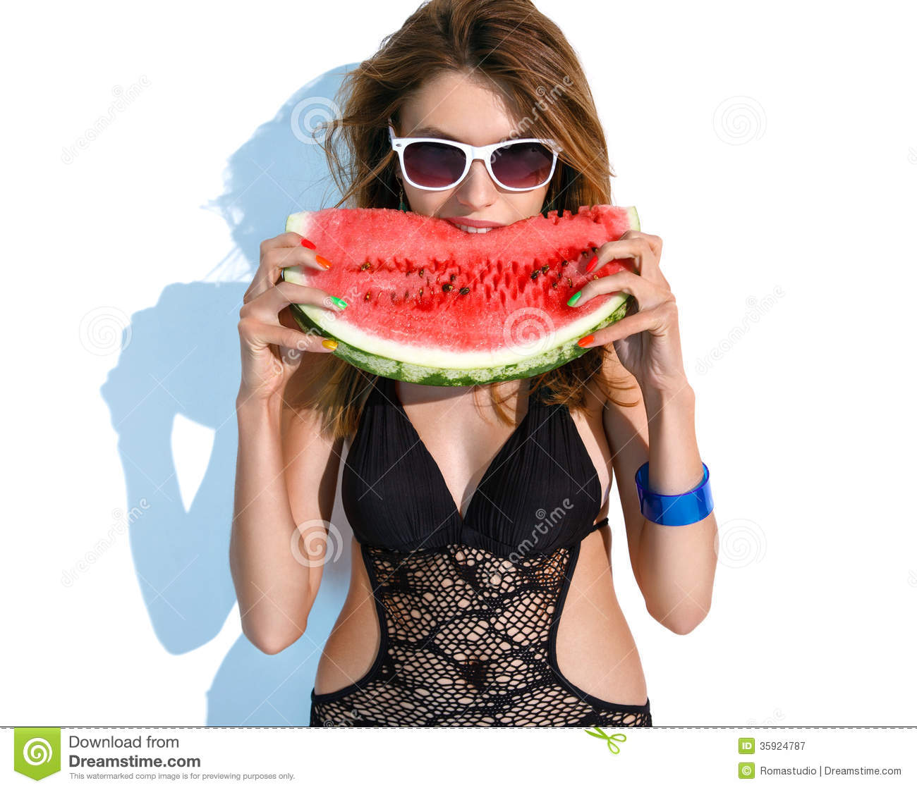 Tourist girl with a slice of watermelon