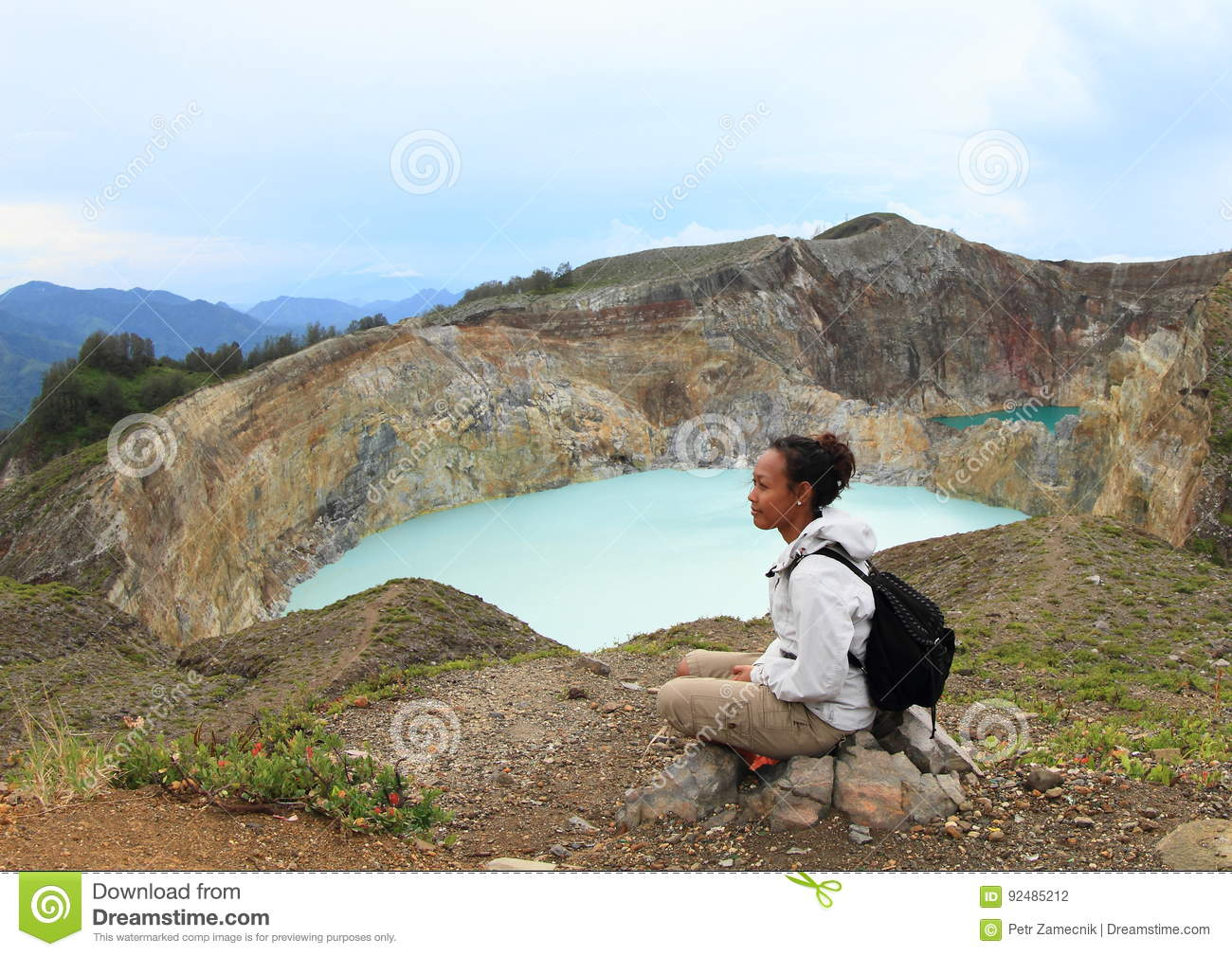 Tourist on Kelimutu watching unique lakes Tap and Tin