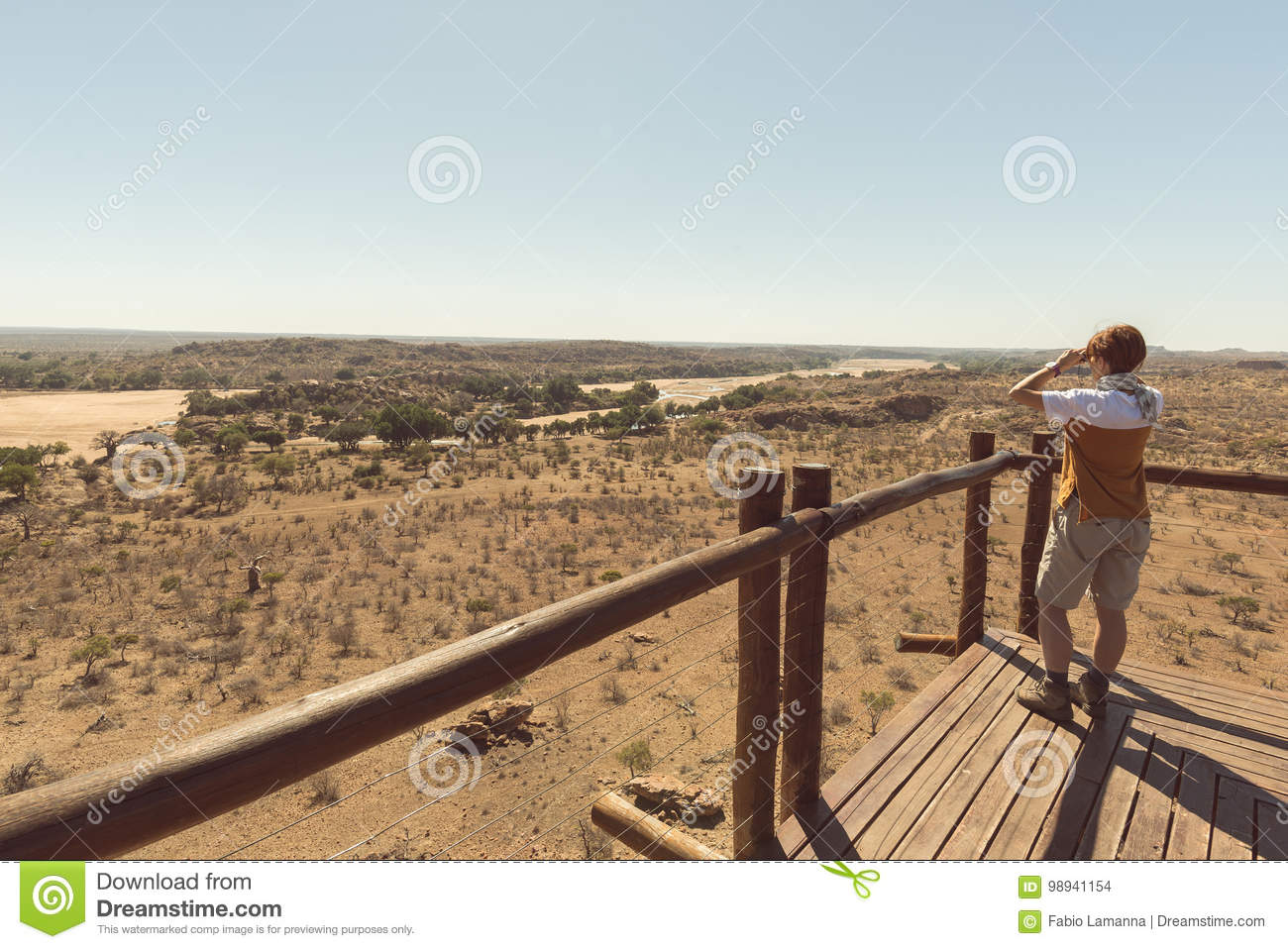 Map Of Africa Viewpoint.Tourist Looking At Panorama With Binocular From Viewpoint Over The