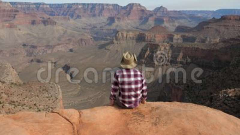 ddd39e6786c Man Sitting Alone On Edge Of The Abyss Looking Amazing View Of Grand Canyon  Stock Footage - Video of amazing