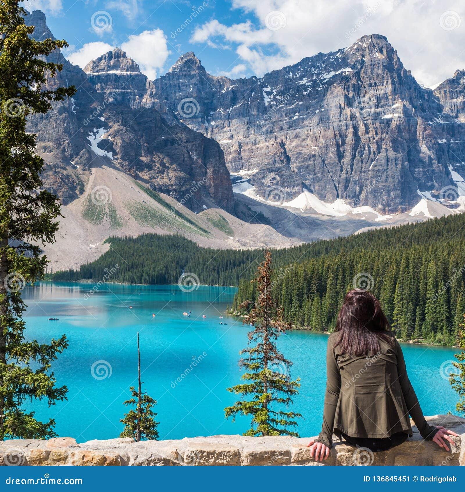 Tourist At Moraine Lake In Banff National Park Alberta