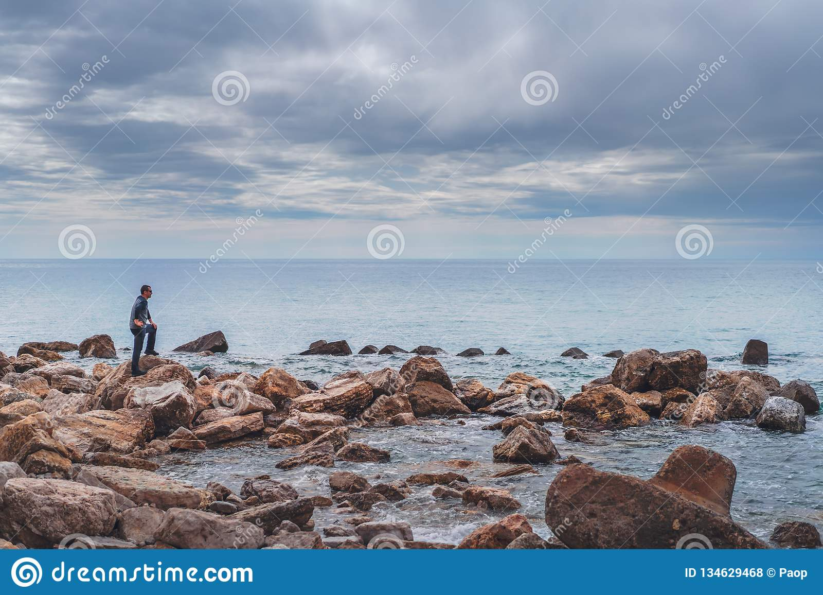 Tourist on the rocky coast in Montenegro