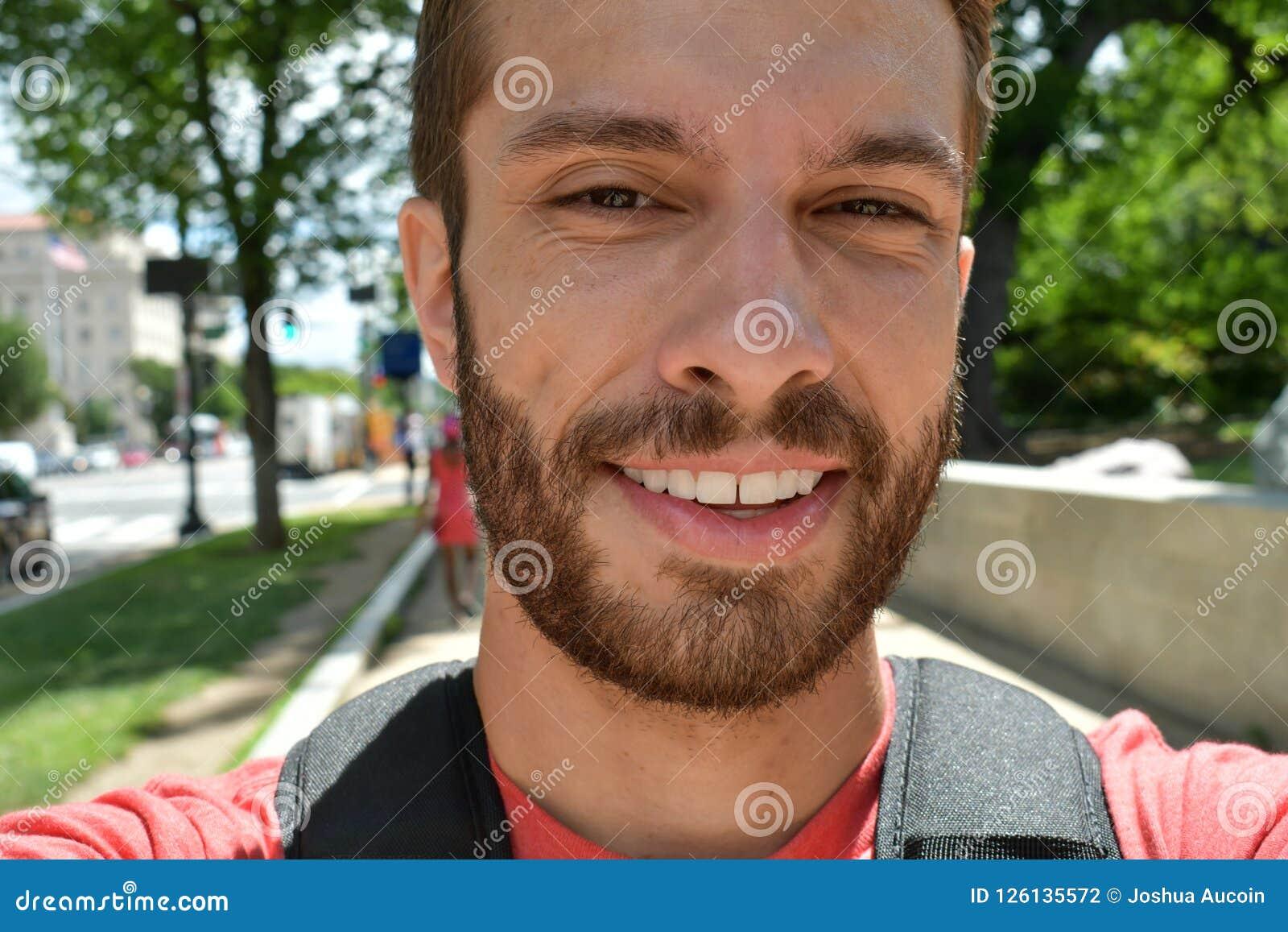 Tourist takes a selfie while walking