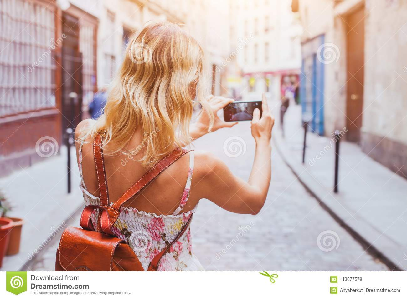 Tourist taking photo on the street, tourism and travel