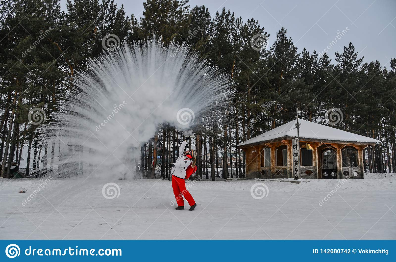 A tourist throwing hot water at winter park