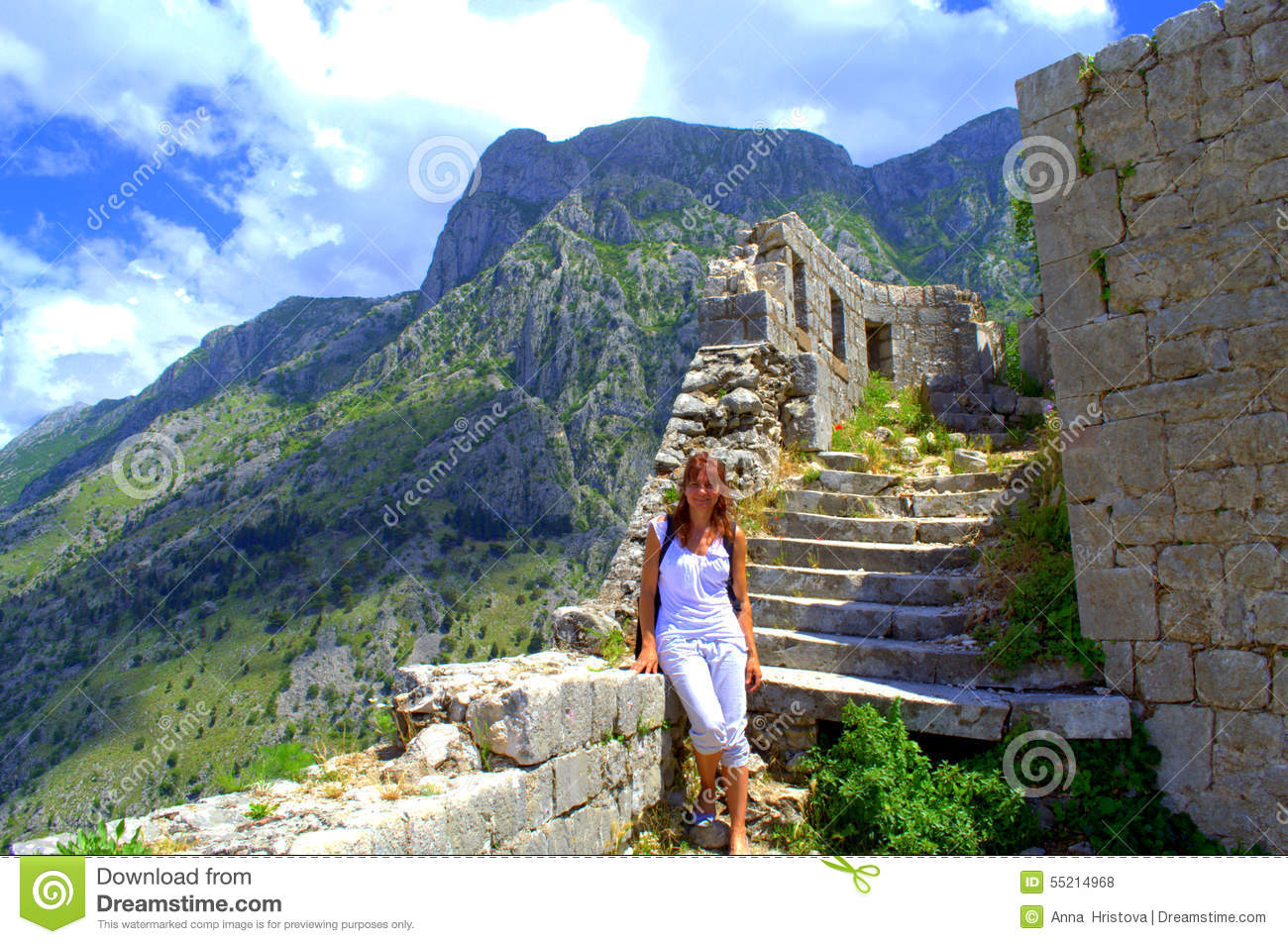 Tourist Woman Hiking In Ancient Fortifications Stock Photo