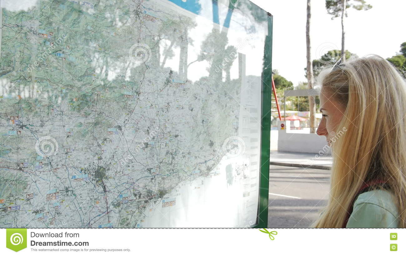 Tourist Woman Looking At Map Side View Of Female Person Lost In