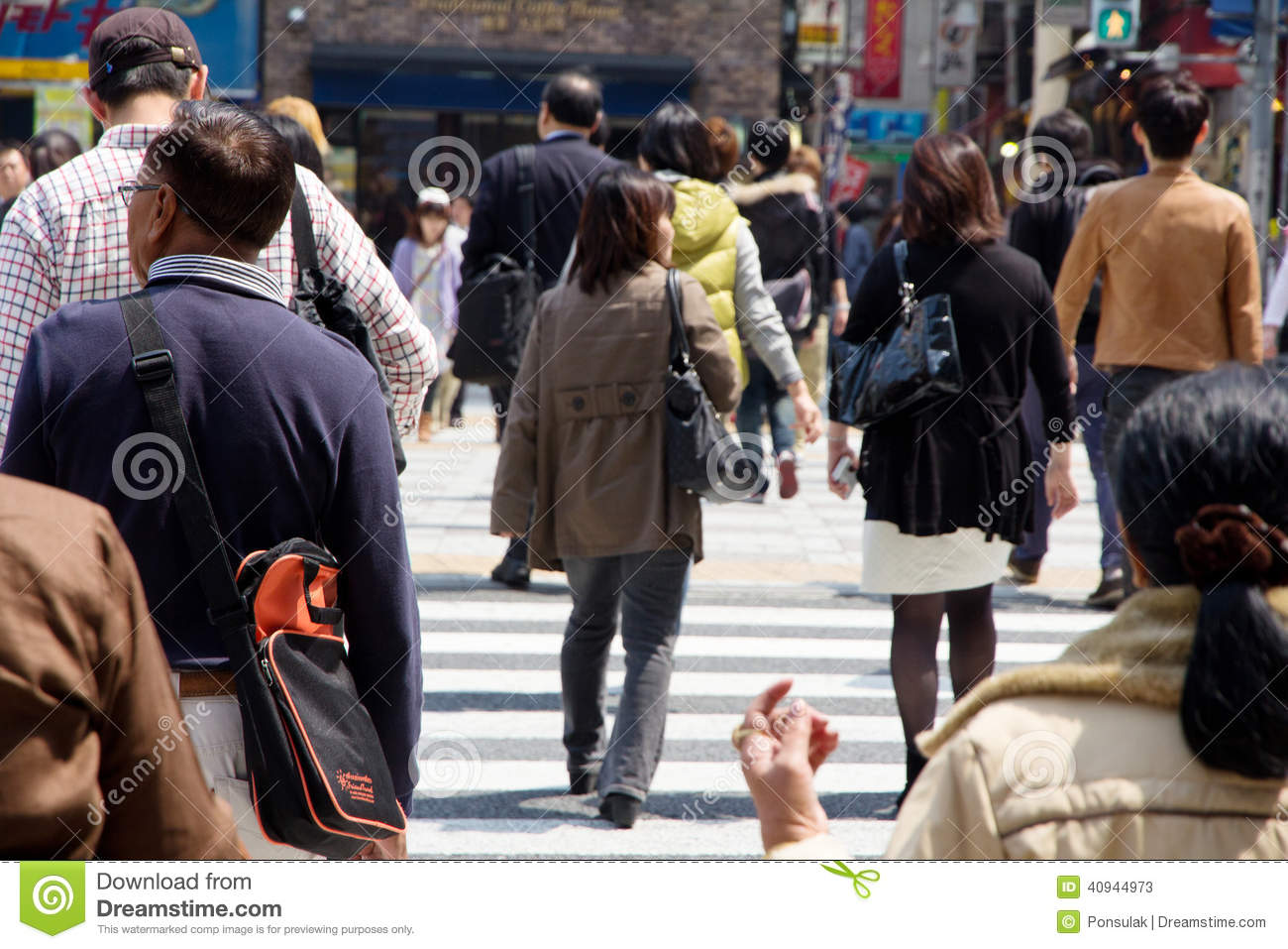Tourists and business people crossing the street