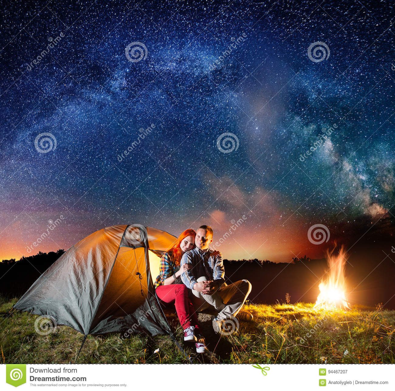 Tourists In Camping At Night Against Starry Sky Stock ...