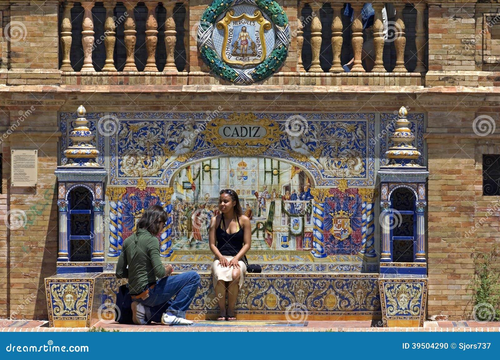 Tourists, colorful tiles, Plaza de Espana, Seville