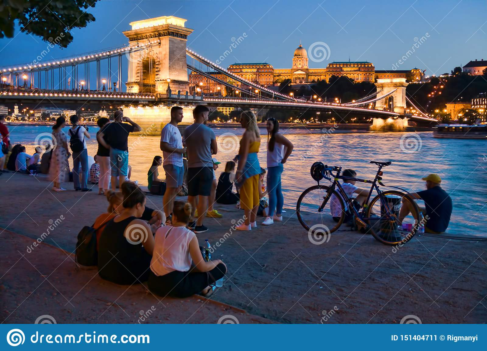Tourists by the Danube river in Budapest