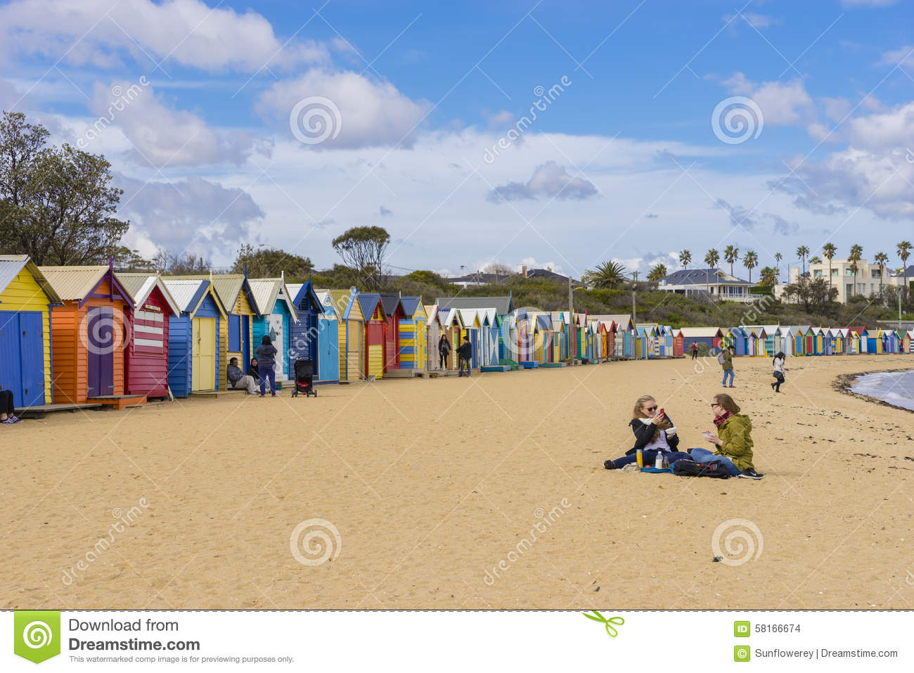 Tourists at dendy street beach brighton with colourful for Beach house designs melbourne