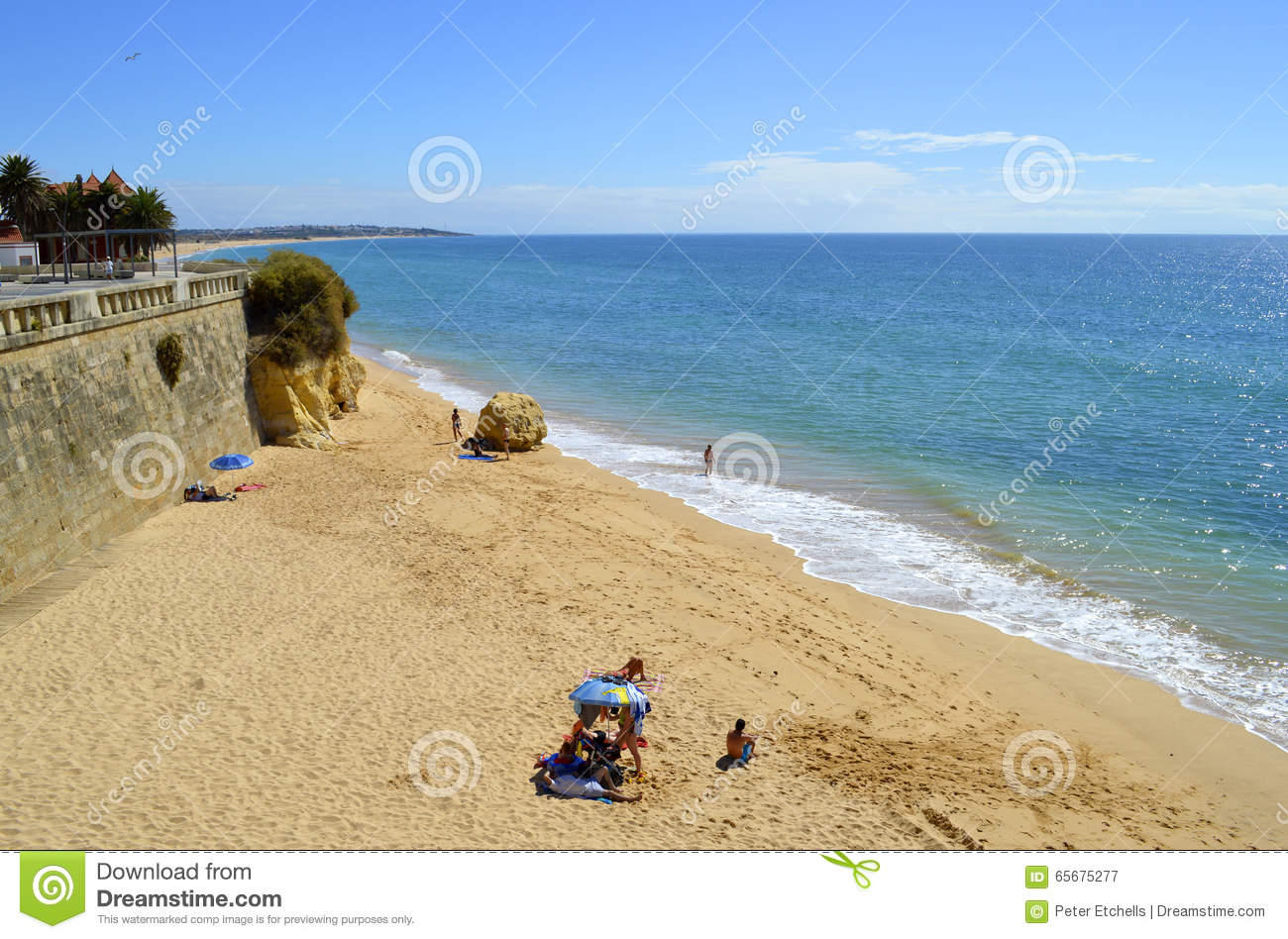 tourists enjoying sunny weather on armacao de pera beach on the algarve coast editorial photography