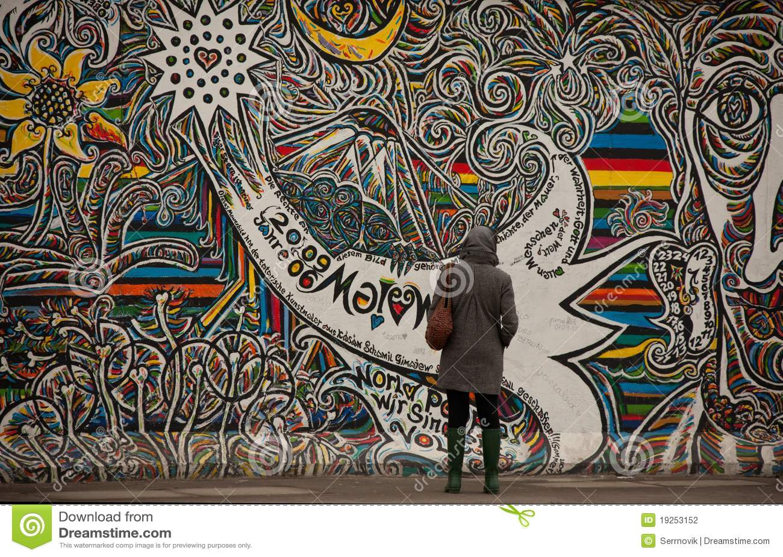 Tourists Examine Graffiti On Berlin Wall Editorial