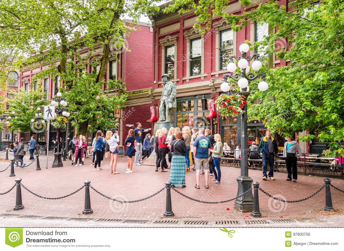 Tourists in Front of the Gassy Jack Statue in Gastown, Vancouver, Canada