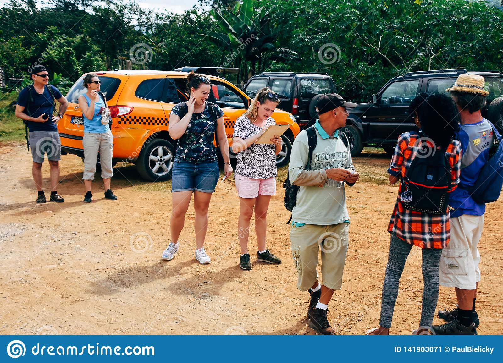 Tourists getting ready for a hike in the rain forests near Trinidad, Cuba.