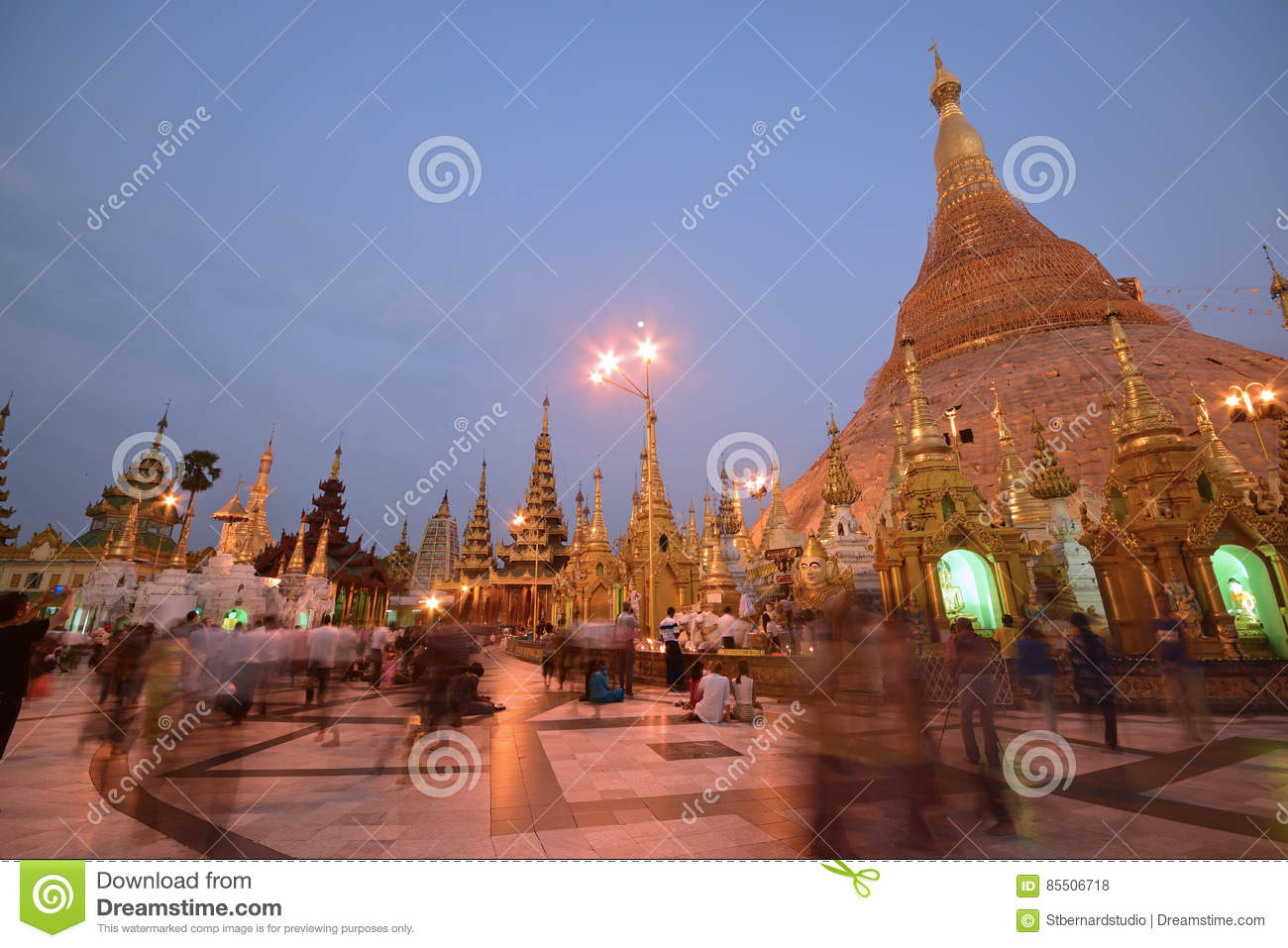 Tourists and local Devotees in crowded Shwedagon Pagoda in the evening during sunset