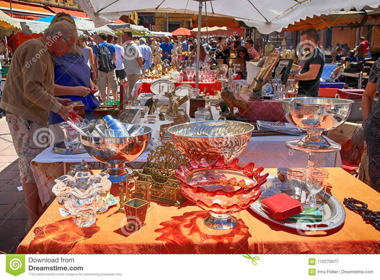 Tourists and local people buy old goods at famous antique market