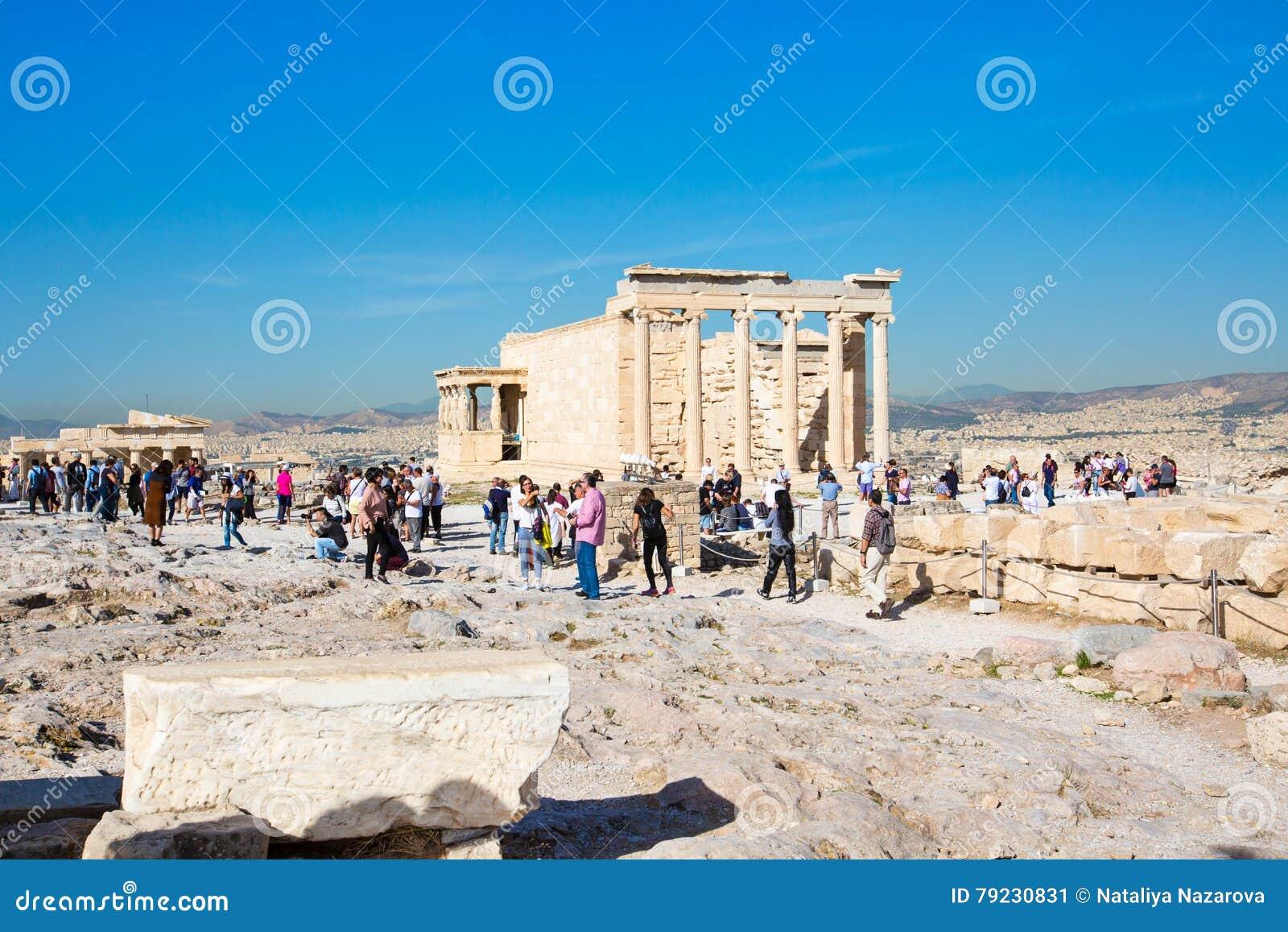 Tourists near Erechtheum temple ruins in Acropolis, Athens