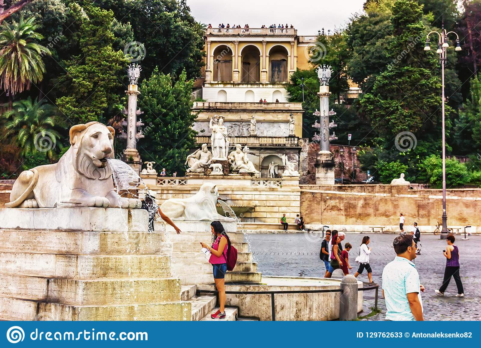Tourists Near The Fountains In Piazza Del Popolo In From Of