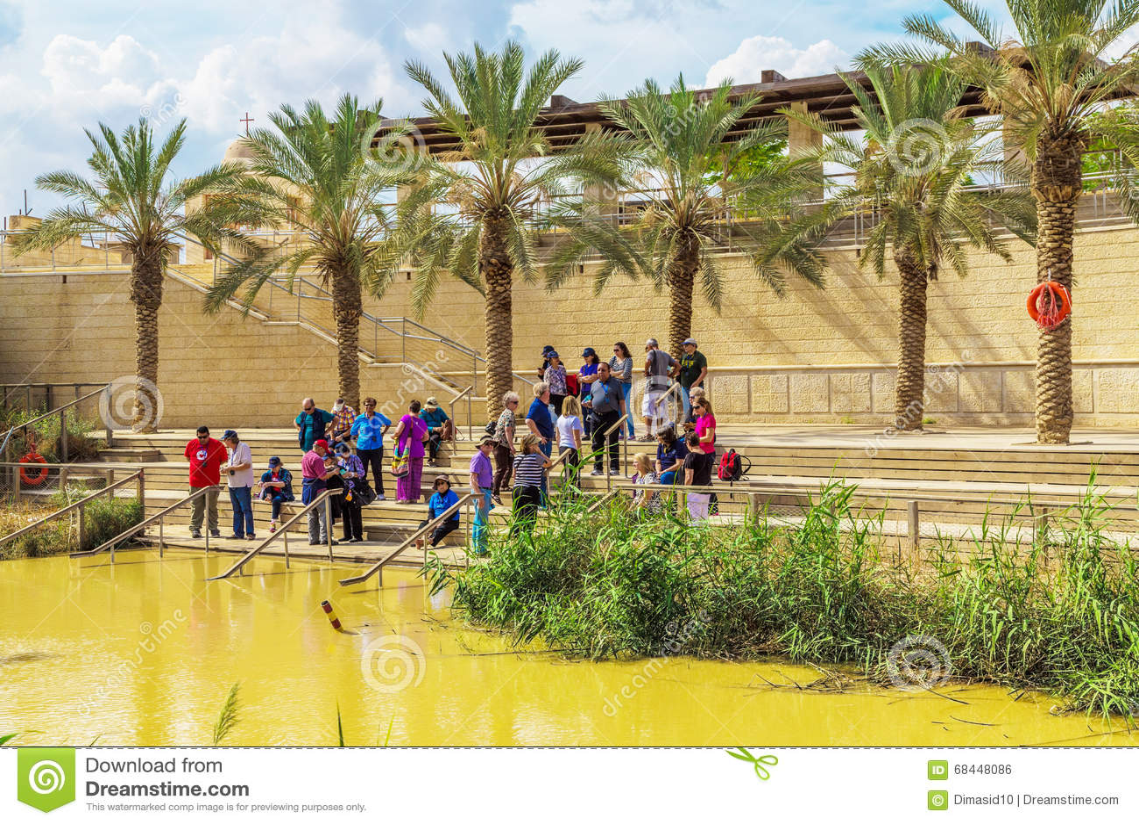 tourists near jordan river at the site of jesus u0027 baptism