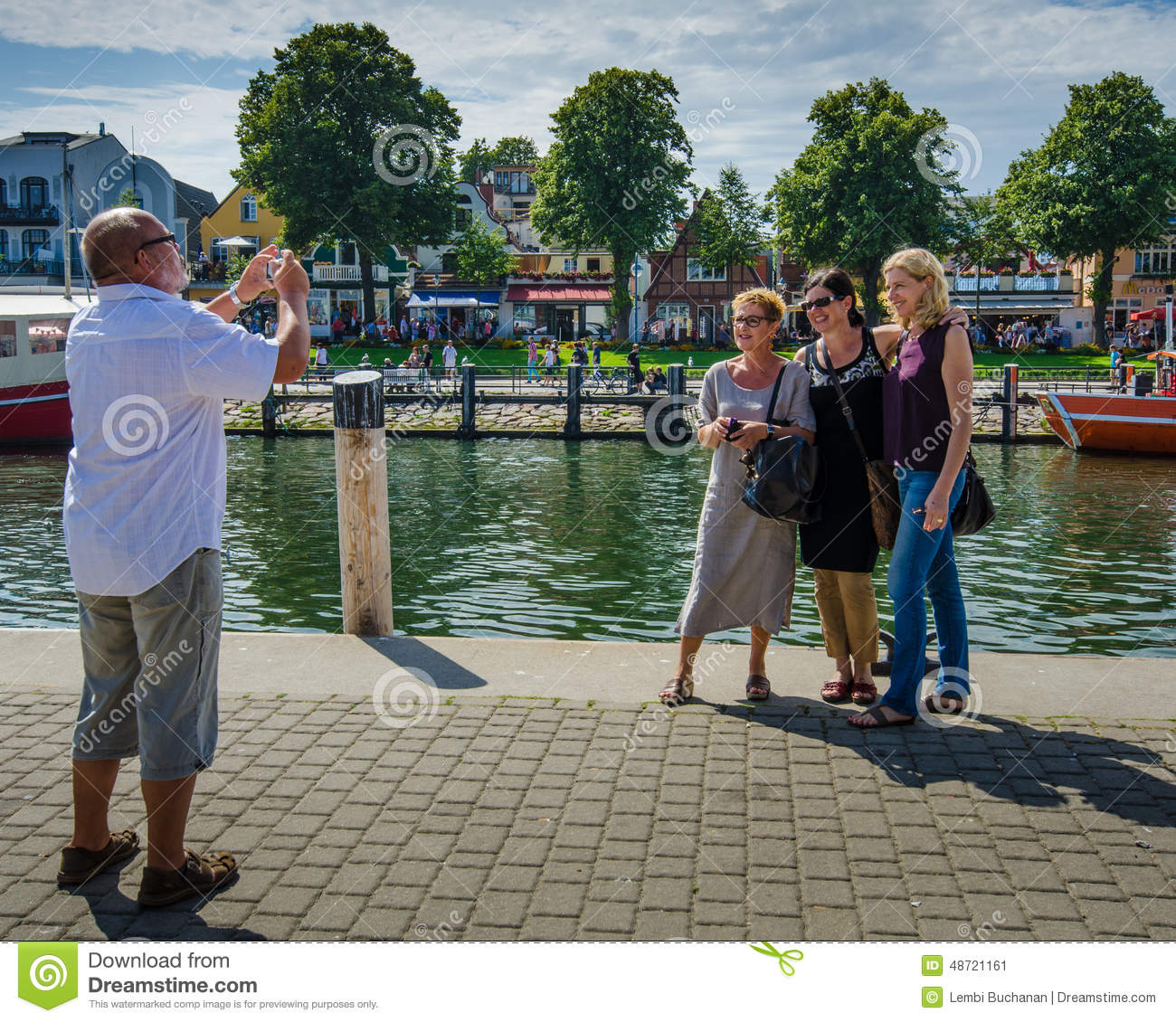 Tourists pose for photos in historic seaside resort of for Resort warnemunde
