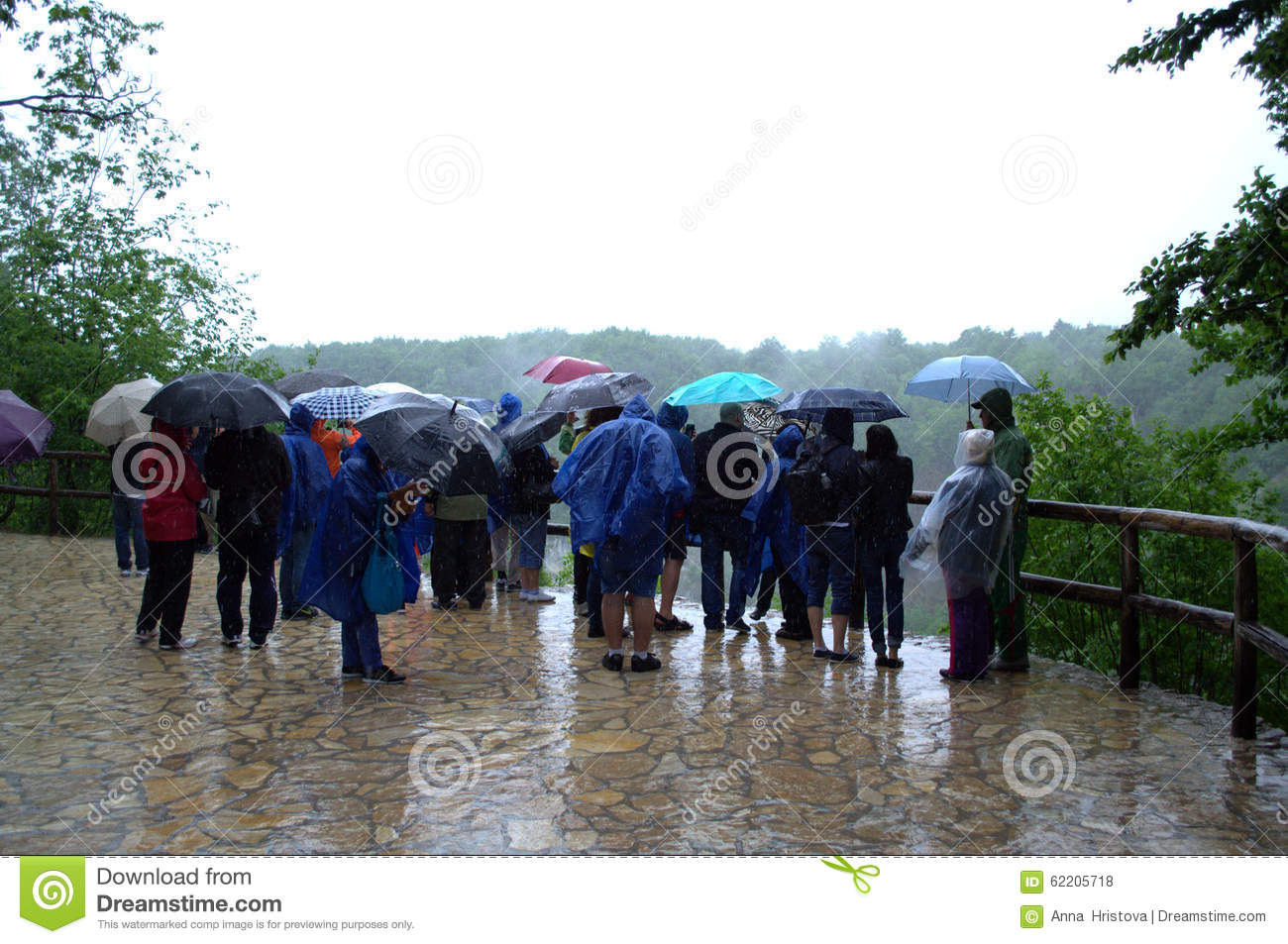 Tourists in the rain editorial stock photo image 62205718 for The terrace group
